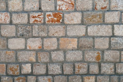 Stone wall with cement Stock Photography
