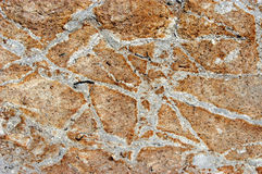 Stone wall cemented together. Stones of various irregular sizes  cemented together to make a wall Stock Image