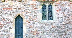 Stone wall of church with door and windows Royalty Free Stock Photos