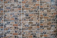 Stone wall cladding made of artificial rocks panels. It is used for exteriors but also for rustic interiors. Stone wall cladding made of artificial rocks panels royalty free stock photography