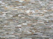 Free Stone Wall Cladding Made Of Stacked Stripes Rocks. The Colors Are From White To Gray And Brown. Stock Photos - 122810323