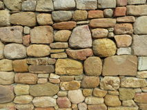 Stone Wall close-up. Close-up of honey-colored natural stone wall Stock Photos