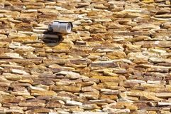 Stone wall closeup with in CCTV camera Royalty Free Stock Photos