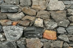 Stone wall closeup Stock Images