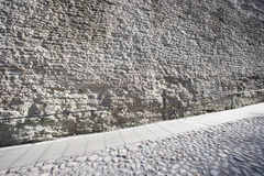 Stone wall and cobblestone street, Tallinn, Estonia, Europe Stock Photo