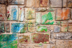Stone wall with colorful spots Stock Images
