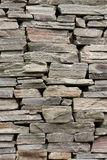 Stone wall constructed from raw stones Royalty Free Stock Photography