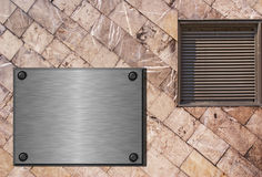 Stone wall construction. Stone slab wall with grating and brushed metal plate Royalty Free Stock Photography