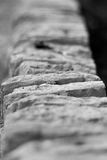Stone wall coping. Shallow depth of field view of a stone wall coping Royalty Free Stock Images