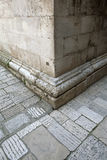Stone wall corner. Of ancient building on stone street royalty free stock image