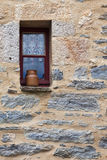 Stone wall of a cottage with a small window Royalty Free Stock Photos