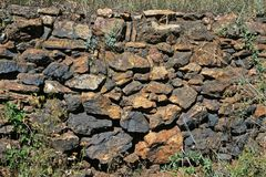 Stone wall in countryside. View of crudely built old stone wall using stacked randomly sized rocks Royalty Free Stock Image
