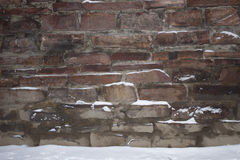 Stone wall. Covered with snow close-up Royalty Free Stock Photos
