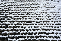 Stone wall covered with snow i Stock Photo