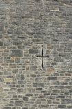 Stone wall and cross Royalty Free Stock Image