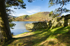 Stone wall into Crummock Water Royalty Free Stock Photos