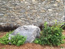 Free Stone Wall, Decorative Gray Boulder And Ornamental Green Plants. Royalty Free Stock Photography - 211309307