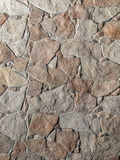 Stone wall. Decorative stone wall of gray-brown stone of different sizes Royalty Free Stock Image