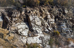 Stone wall of deep unused stone quarry Stock Photography