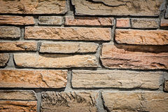 Stone Wall. Detailed close up of the surface of black natural stone wall. A great texture image for a background or overlay royalty free stock photography