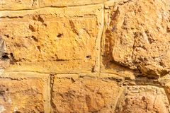 Stone wall details, different sizes of stones stock photography