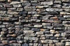 Stone wall with different stones Royalty Free Stock Photos