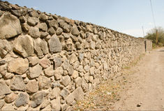 Stone Wall and dirt road Royalty Free Stock Photos