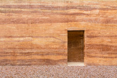 Stone wall with door and stone floor in front off Royalty Free Stock Photography