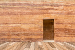 Stone wall with door and wood floor in front off Stock Photo