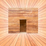 Stone wall and door in wood plank room Royalty Free Stock Photography
