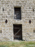 Stone Wall and Doors Stock Photo