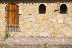 Stone wall with doors and windows in the old style Stock Photo