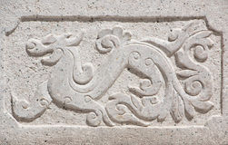 Stone wall dragon carved in China pattern. Stone wall dragon carved in China pattern Royalty Free Stock Photos