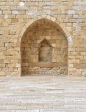 Stone wall with embedded niche Stock Photo
