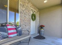 Stone wall entry with bench near front door royalty free stock images