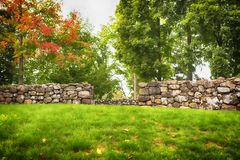 Stone wall and fall foliage in autumn in new england. A rock wall and fall foliage on the Hillstead Museum property in Farmington connecticut in hartford county royalty free stock images