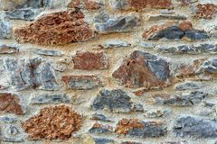 Stone wall fence rustic texture background close-up. stock photography