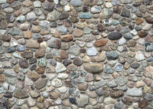 Stone wall fieldstone and concrete natural building texture. Stone and concrete wall, color rocks fieldstone texture background Stock Image