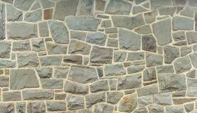 Stone wall fieldstone grey rock background. Rock background stone wall ancient fieldstone house Royalty Free Stock Photography