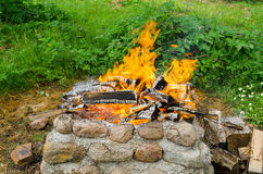 Stone wall fireplaces  quiet burn firewood Stock Photography