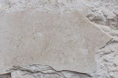 Stone wall fragment. Texture of polished stone with copy space stock photos