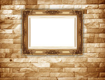 Stone wall and gold frame. Stock Photo