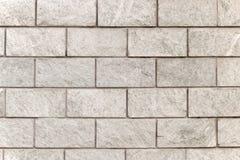 Stone wall. Grey Stone wall background - geometric Stock Photo