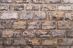 Stone wall grey brick stones texture background.  stock images