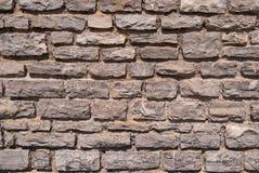 Stone wall grey brick stones texture background.  stock photography