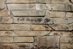 Stone wall of grey dirty broken slate background. rocky backgrou Stock Images
