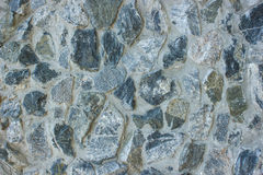 Stone wall. Grey old  stone wall composed of natural material Stock Photography
