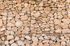 Stone wall in a grid as a background Stock Photos