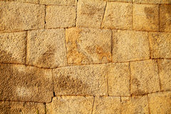 Stone wall of the hampi fort. Detail of the fort wall made of cut granite at Hampi, India. The granite blocks are cut and placed tightly to form this nearly 5 stock image