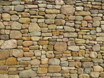 Stone Wall. Honey-colored natural stone wall Stock Photography